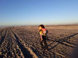 Elliot carries girl_San Diego